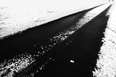 Dangerous icy road. Dangerous icy snow covered road Stock Image