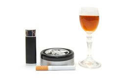 Dangerous items - cigarette, cognac, lighter Royalty Free Stock Photography