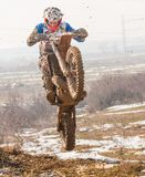 Motocross jump. Motocross racer making dangerous jump stock photography