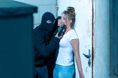 Dangerous kidnapper and victim. Dangerous kidnapper and his young female victim Stock Photo
