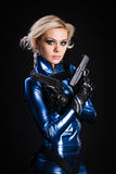 Dangerous lady. Young lady with two guns royalty free stock photo
