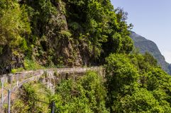 Dangerous Levada walking path on Madeira, Portugal stock image