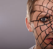 Dangerous look. Man with spider makeup Royalty Free Stock Photo