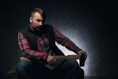 Dangerous-looking axeman. Lumberjack with weapon Royalty Free Stock Photo