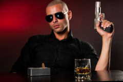 Dangerous man with a gun Stock Image