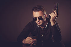 Dangerous man with a gun Royalty Free Stock Images