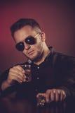 Dangerous man with a gun Stock Images