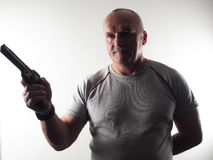 The dangerous man with a gun Royalty Free Stock Photo