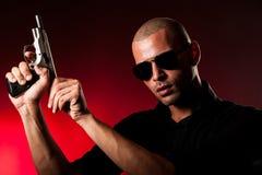 Dangerous man with a gun Stock Photo