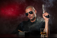 Dangerous man with a gun royalty free stock image