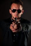 Dangerous man with a gun Stock Photography