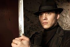 A dangerous man holding dagger Stock Photo