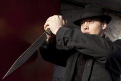 A dangerous man holding dagger Stock Photos
