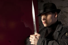 A dangerous man holding dagger Royalty Free Stock Photos