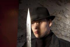 A dangerous man holding dagger Royalty Free Stock Photo