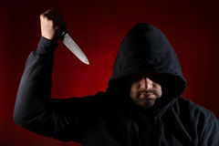 Dangerous man with knife. Against red background royalty free stock photo