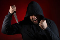 Dangerous man with knife Stock Photography