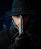 Dangerous man with a knife Stock Photo