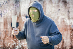 Dangerous man with knife near wall Royalty Free Stock Photos