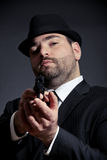 Dangerous man pointing a gun Stock Photography