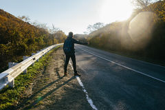 Dangerous man on the road. Try stop the car Royalty Free Stock Images