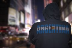 Dangerous man standing on a city street with black hoodie with text argentina on his back stock photography