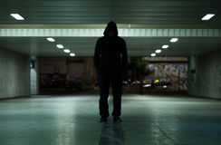 Dangerous man walking at night Stock Photos