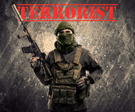 Dangerous masked and armed man with terrorist sign on grungy bac Royalty Free Stock Images