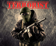 Dangerous masked and armed man with terrorist sign on grungy bac Stock Photos