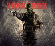 Dangerous masked and armed man with terrorist sign on grungy bac Royalty Free Stock Photography