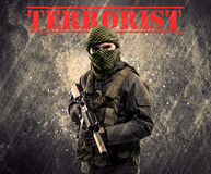 Dangerous masked and armed man with terrorist sign on grungy bac Stock Image
