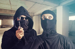 Dangerous masked criminals. Crime and safety concept. Dangerous masked criminals Royalty Free Stock Photography