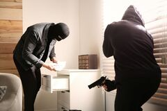 Free Dangerous Masked Criminals With Weapon Stealing Money Stock Photos - 177632213