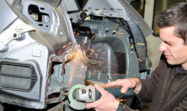 Dangerous mechanical grinding. Stock Images