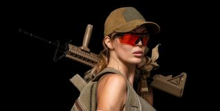 Military girl with automatic rifle. Dooms day. Dangerous military girl holding automatic rifle. Dooms day or war on black stock photo