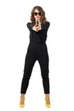 Dangerous mobster woman with sunglasses aiming handgun at camera Royalty Free Stock Images