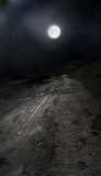 Dangerous Moonlit Road Royalty Free Stock Images