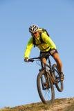 Dangerous mountainbiking - mountainbike downhill. Mountainbiker goes dangerous to public safety Stock Image