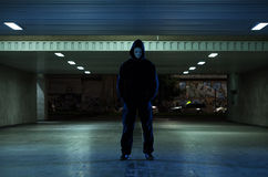 Dangerous mugger in the underpass Royalty Free Stock Photos