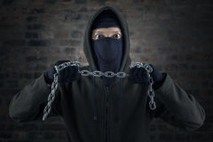 Dangerous murderer holding chain Royalty Free Stock Images