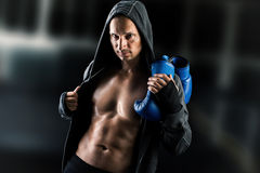 Dangerous  muscular man boxer wearing jacket with hood Stock Images