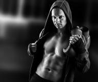 Dangerous  muscular man boxer wearing jacket with hood Royalty Free Stock Image