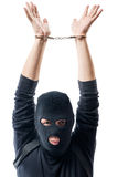 Dangerous offender in handcuffs, hands over head on a white. Background royalty free stock images