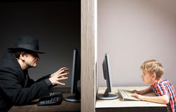 Dangerous online friendship concept. Internet communication between teen and dangerous anonymous Royalty Free Stock Photos