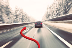 Dangerous overtaking car at high speed concept. Dangerous overtaking cars on the road with added illustrated red arrow (concept). Vintage blurry black car high Stock Image