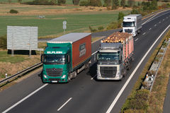 Dangerous overtaking of trucks Royalty Free Stock Photos