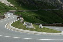 Dangerous panoramic serpentine road high in the Alps Stock Photo
