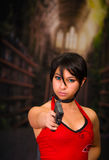 Dangerous powerful Woman Holding a Gun, resident evil cosplay costume Stock Photos