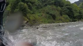 Dangerous rafting on wild mountain river, severe conditions testing team spirit. Stock footage stock video footage