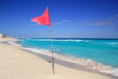 Dangerous red flag in beach rough sea signal Royalty Free Stock Images